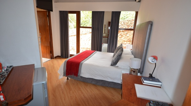 Double room with flat screen LED, coffee station, mini bar fridge, small desk and en-suite bathroom.